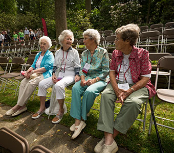 Photo of four women talking. Link to Life Stage Gift Planner Over Age 70 Gifts.